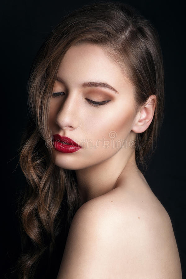 High fashion look. glamor closeup portrait of beautiful stylish brunette young woman model with bright makeup with red lips. royalty free stock images