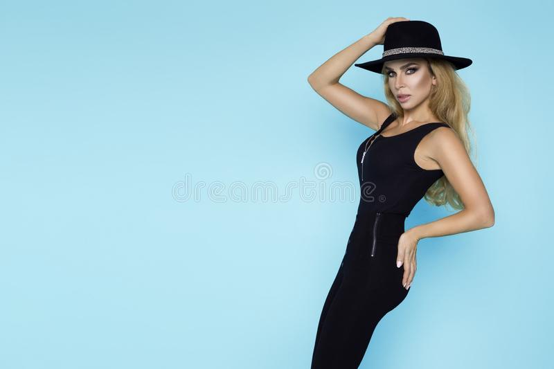 High fashion Model girl portrait isolated on blue background. Beauty stylish blonde woman posing in fashionable clothes in studio. Casual style, beauty stock photos