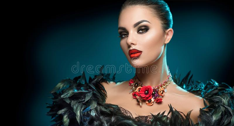 High Fashion Model Girl Portrait with Trendy gothic make-up, Black Hair style, Make up, dark accessories over black background stock photography
