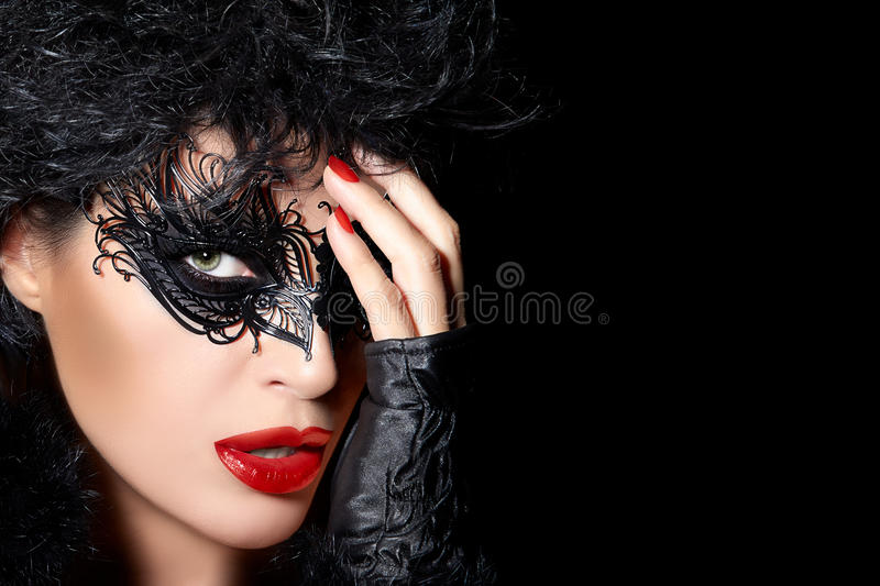 High Fashion Model Wearing Creative Masquerade Eye Makeup. Dark evocative portrait of a glamorous beauty model wearing creative masquerade eye makeup with black royalty free stock photos