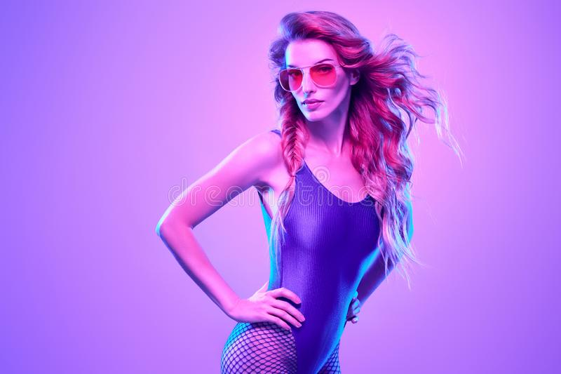 High Fashion neon light.Sexy Girl,Trendy Hairstyle. High Fashion neon light. Glamour Girl with Trendy Wavy Hairstyle, Stylish Sunglasses. Creative Bright stock image