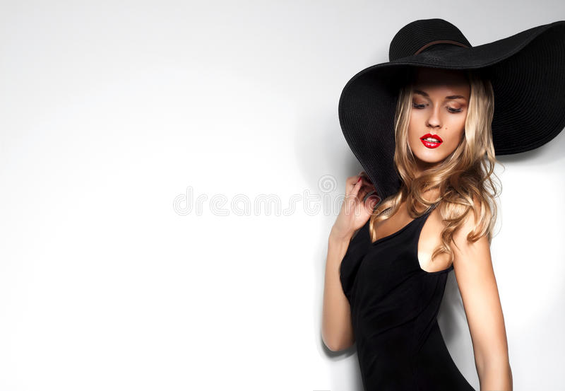 High fashion shot of blonde woman with curly hair royalty free stock photos