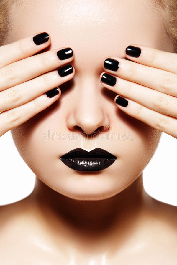 High fashion style, manicure. Black lips & nails. High fashion beauty model. Black lips, nails & oily skin make-up. Portrait beautiful woman on white background stock images