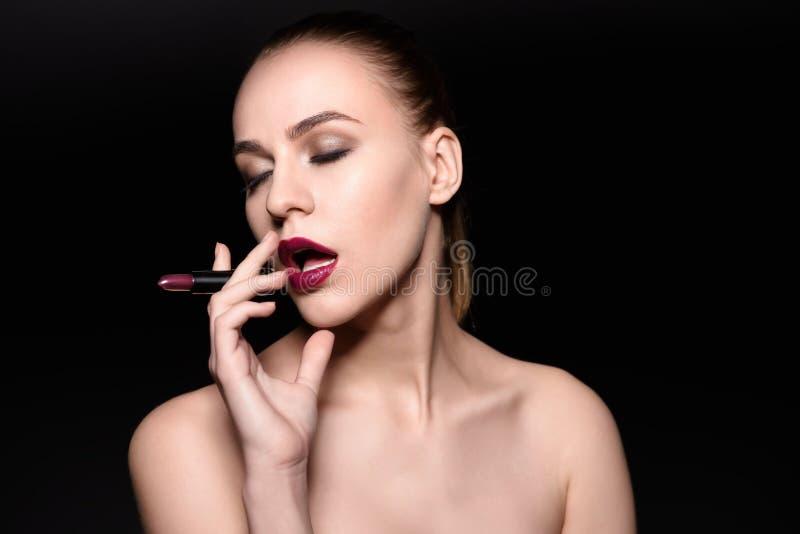 High Fashion Woman Portrait. Model Smoking. Lipstick, Beauty Girl with Dark Violet Lips royalty free stock image