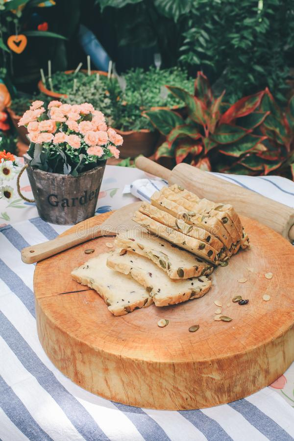 High fiber natural health food Sliced rye bread on cutting board. Whole grain rye bread with seeds stock images
