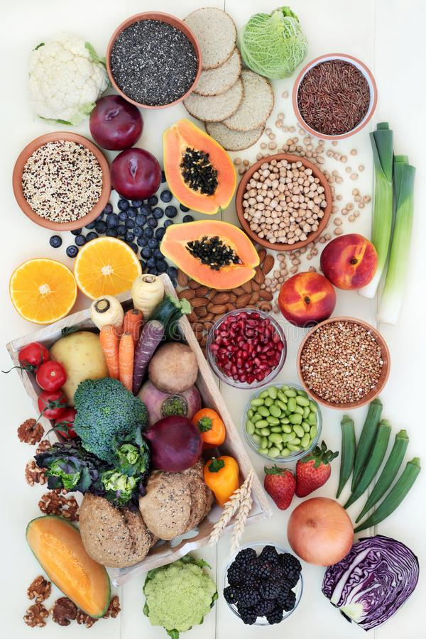High Fibre Health Food. With fresh fruit & vegetables, grains, legumes, seeds, nuts and whole grain crackers, bread rolls, also high in omega 3, anthocyanins royalty free stock photos