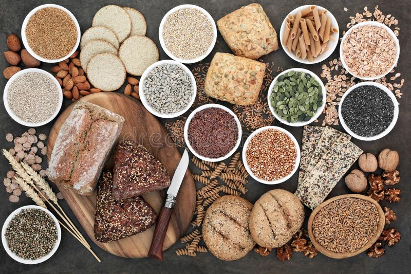 High fibre health food with whole grain bread and rolls, whole wheat pasta, grains, nuts, seeds, oatmeal, oats, crackers, barley royalty free stock image