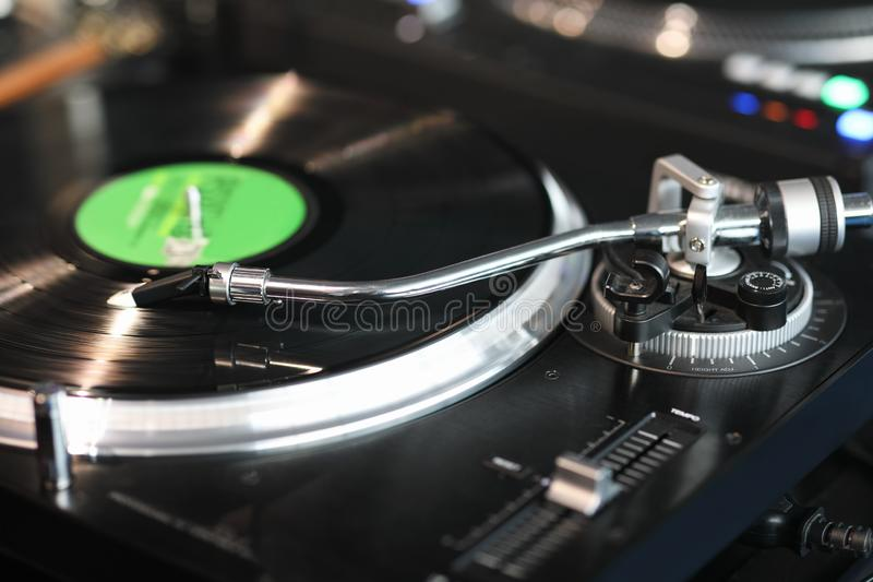 High fidelity turntable playing a vinyl record stock images