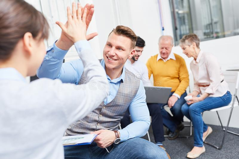 High Five between successful man and woman royalty free stock photography