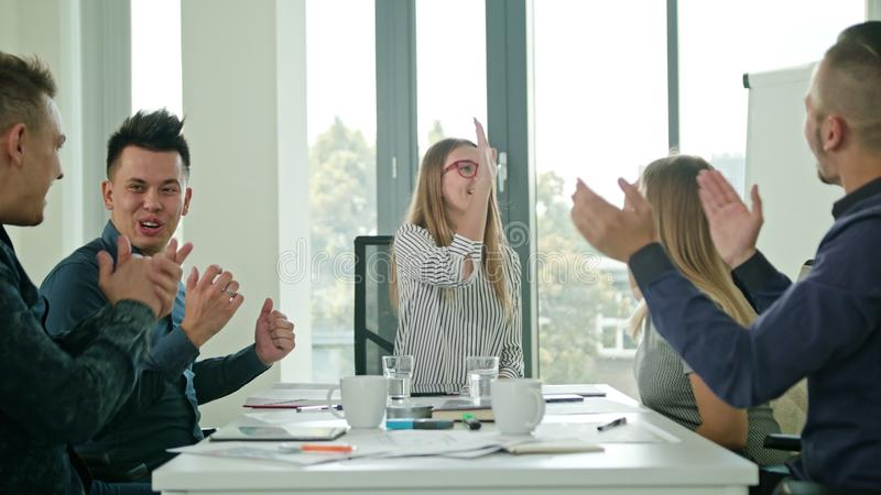 High Fives Members at a Startup in a Modern Office stock photos