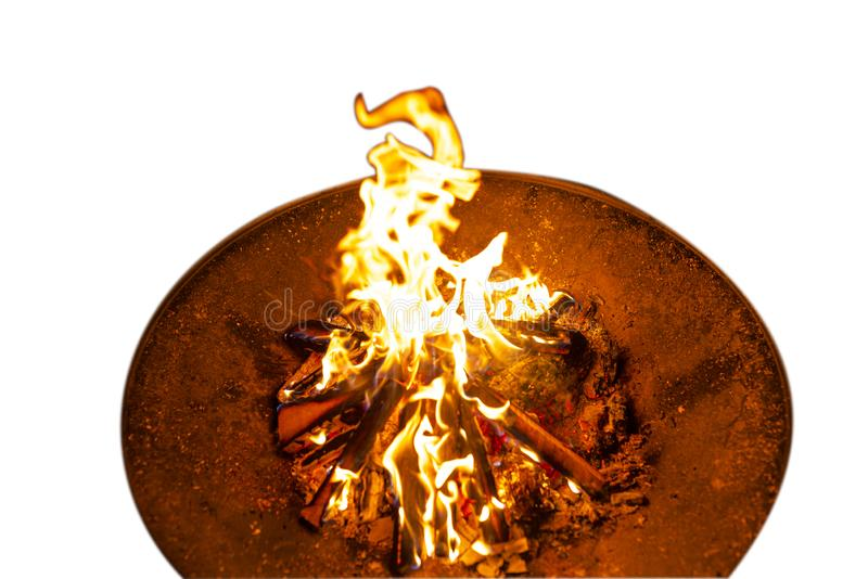 High flames from a burning wood fire on a metal grate at night, isolated on a white background with a clipping path. royalty free stock photos
