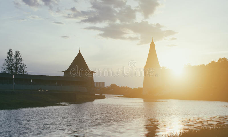 High and Flat towers. High and Flat towers of the Pskov fortress on the sunset stock images