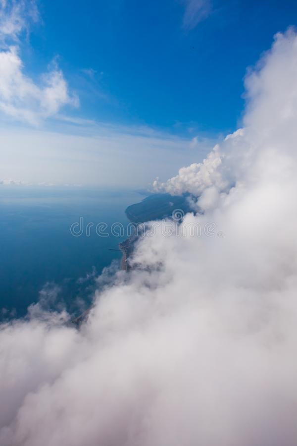 High flight against the wall of clouds over the blue sea view of a paraglider pilot, summer vacation in the Caucasus in Abkhazia stock photo