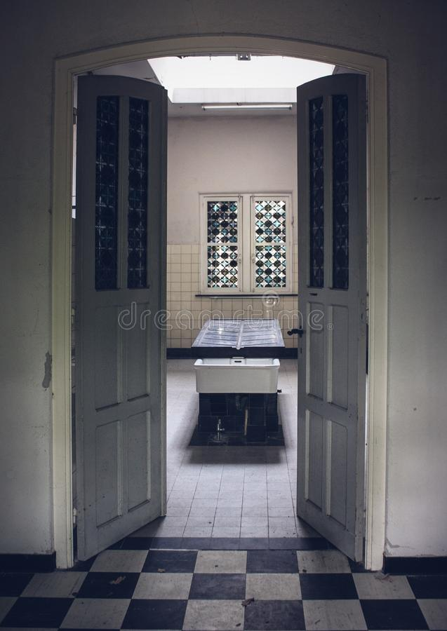 Autopsy table in abandoned psychiatric hospital royalty free stock photos