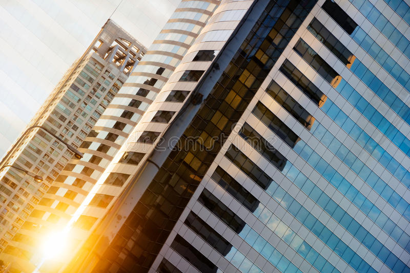 High glass modern building with blue sky and cloud at sunset for royalty free stock photo