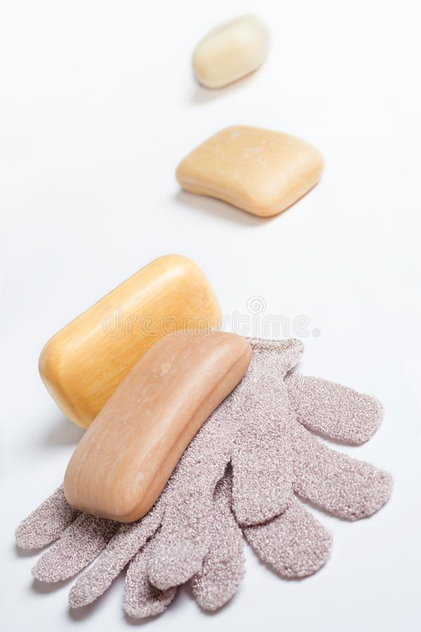 High-grade natural aroma soaps with washing mitten at wite background.  stock image