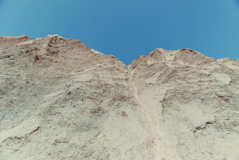 High grey clay hills dried and cracked. Landscape royalty free stock image