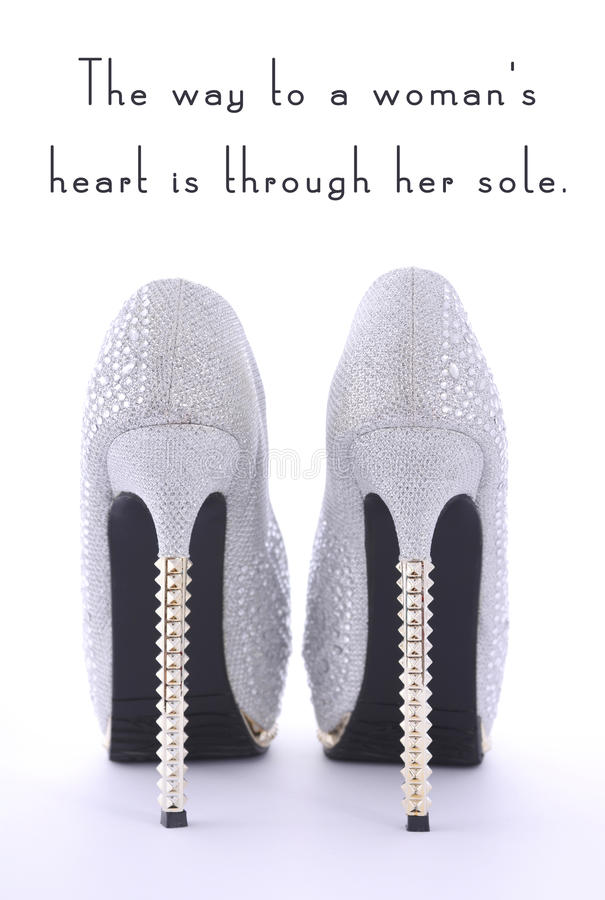 High Heel Rhinestone Shoes with Funny Saying Text. High Heel Rhinestone Shoes with Funny Saying Text, The way to a womans heart is through her sole, on white royalty free stock photo