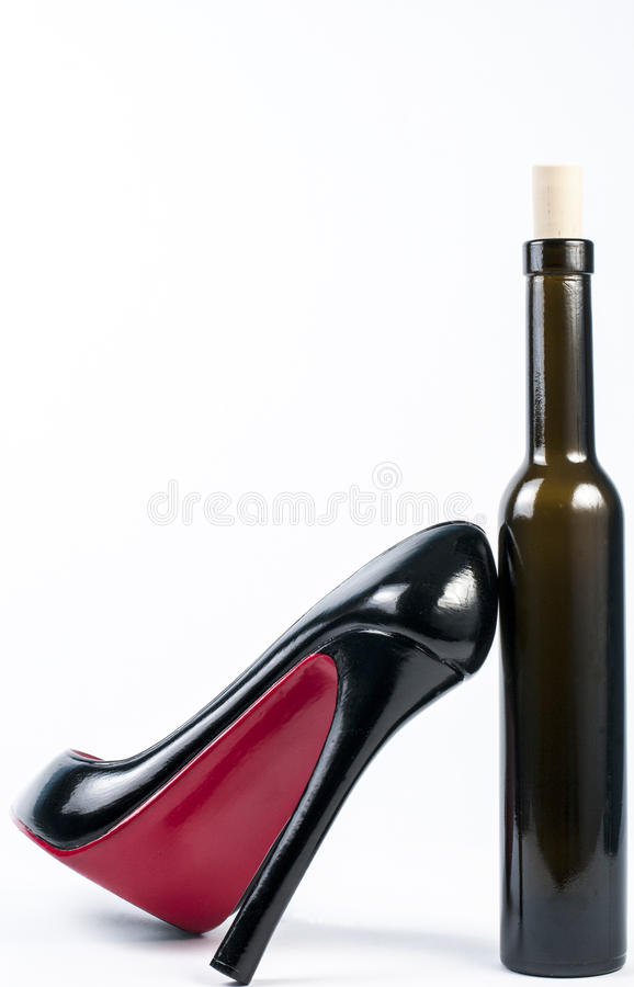 Download High heel shoe with bottle stock image. Image of collection - 28191807
