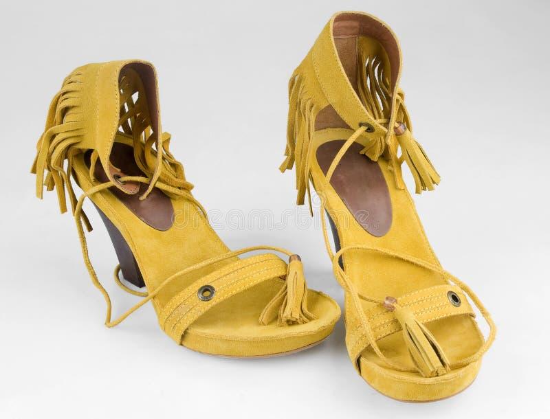 High heel shoes. Woman fashion yellow high heel shoes royalty free stock image