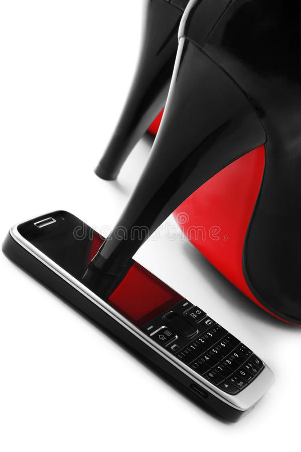 High heel shoes. High heel shoe on cellphone royalty free stock images