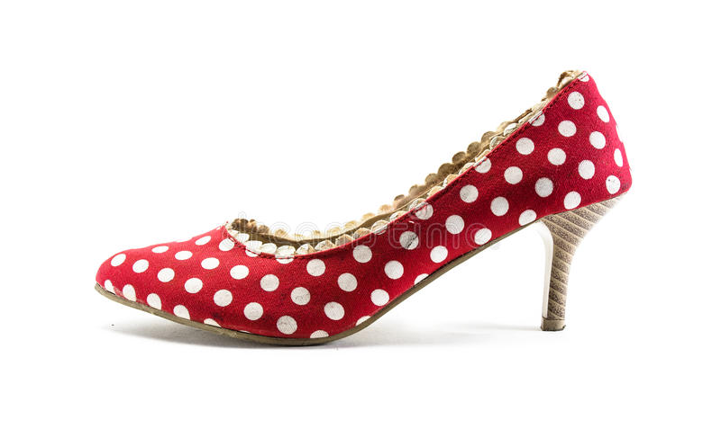 High heel shoes red. Old vintage single high heel shoes red and whit dot general for lady isolated on white background stock images