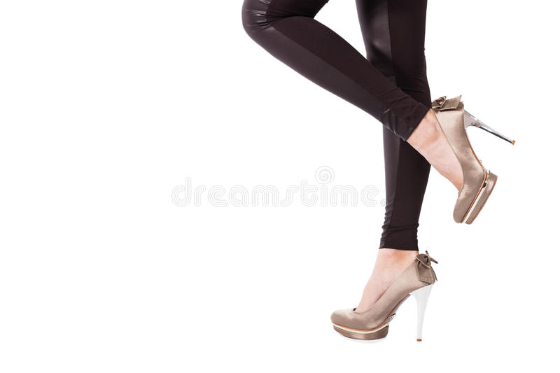 High heel shoes. Woman legs in tights and high heel shoes studio shot royalty free stock images