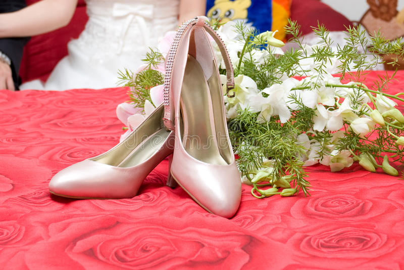 High heels and flowers at a Wedding stock photos