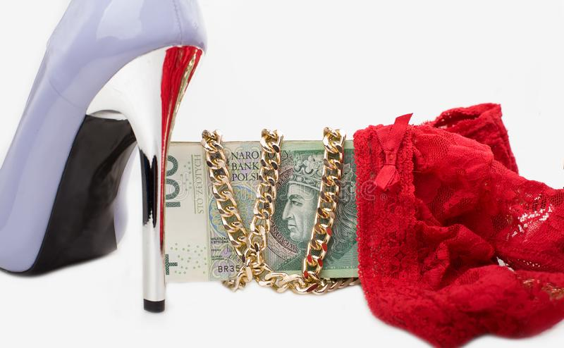 High heels and underwear, money. Women`s shoes, gold on white background stock images