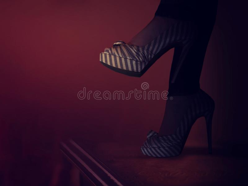 High heels spiked fashionable shoes. Female fashion. Closeup of high heels spiked fashionable shoes on female legs royalty free stock images