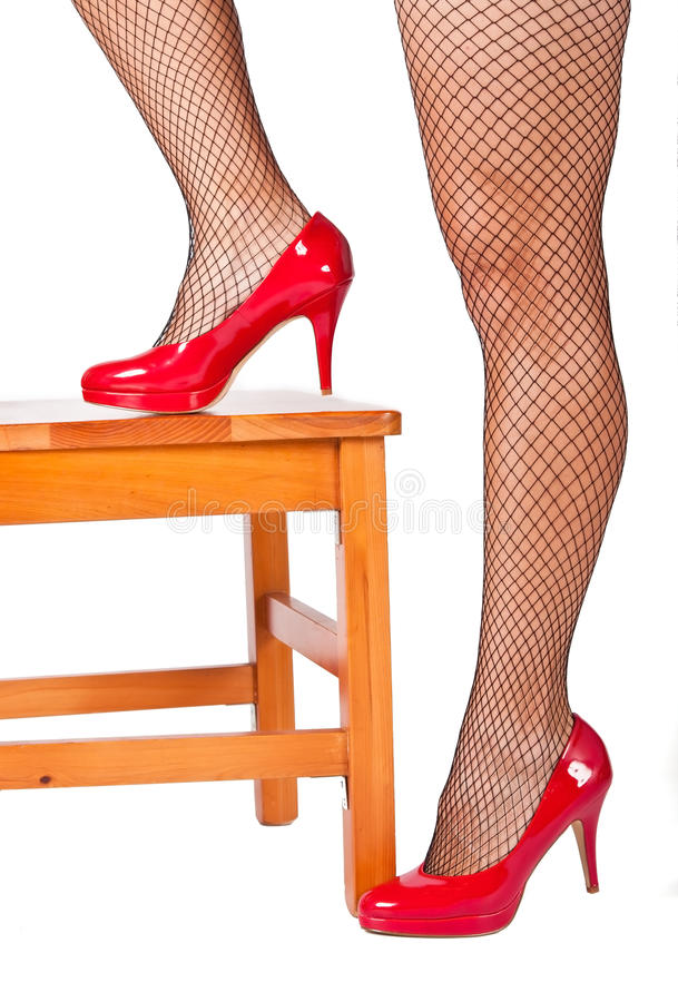 Download High Hill Shoe Resting On Wooden Chair Stock Images - Image: 24978844