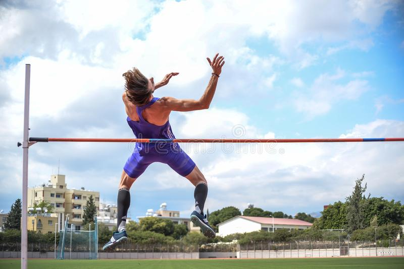 High jump athlete while he jumps. Closeup. High jump athlete while he jumps, on a city court. Photo in day conditions. Closeup stock photos