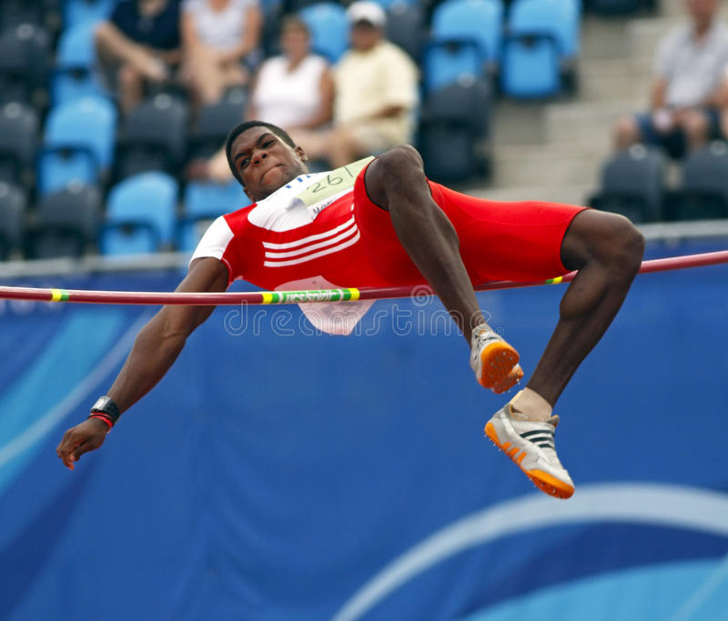 High jump decathlon cuba. MONCTON, CANADA - JULY 20: Jose Angel Mendieta of Cuba performs the high jump as part of the decathlon during the 2010 IAAF World stock photo