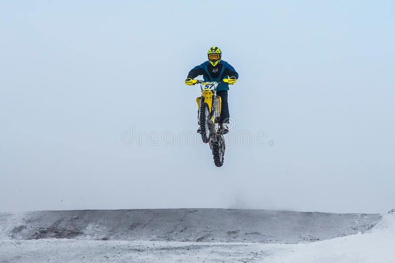 High jump and flight athlete motorcycle on a winter road. Miasskoe, Russia - January 16, 2016: high jump and flight athlete motorcycle on a winter road during stock images