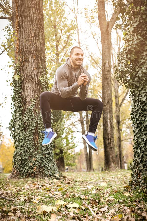 High jump. Man working exercise. stock photo