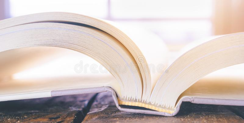 High key closeup of an open book. With white pages, reading and literacy concept stock photo