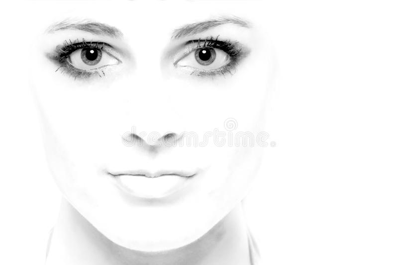 High Key Face. High key image of a young woman's face royalty free stock image