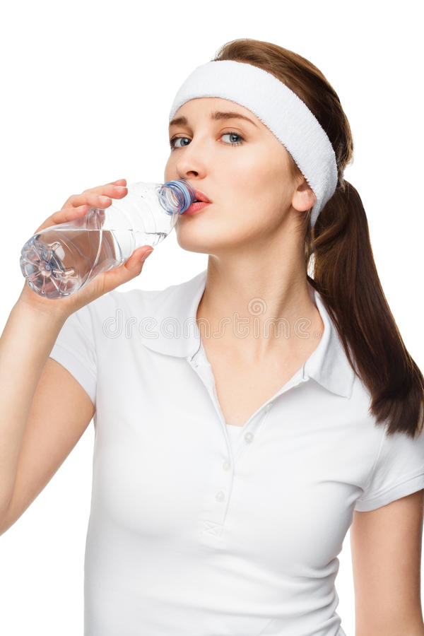 High key Portrait of attractive young woman drinking water isolated on white background. High key Portrait of attractive healthy young woman drinking water stock images