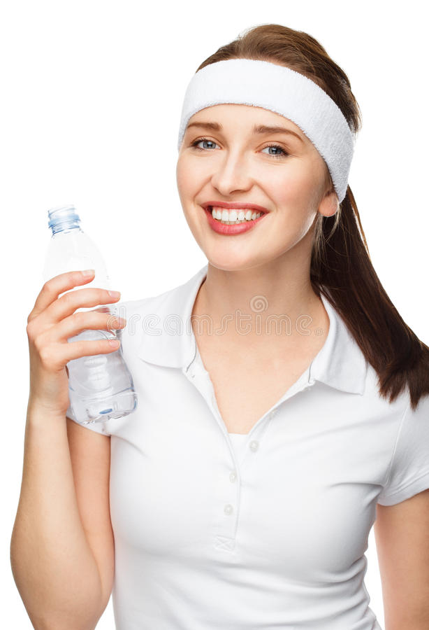 High key Portrait of attractive young woman drinking water isolated on white background. High key Portrait of attractive healthy young woman drinking water royalty free stock photo