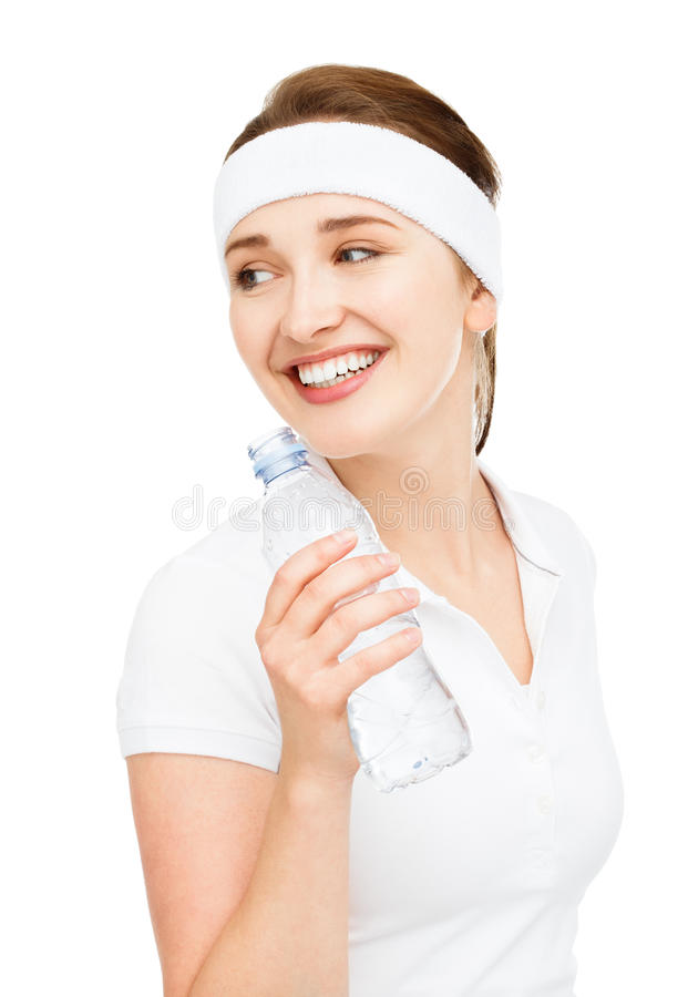 High key Portrait of attractive young woman drinking water isolated on white background. High key Portrait of attractive young woman drinking water smiling royalty free stock photography