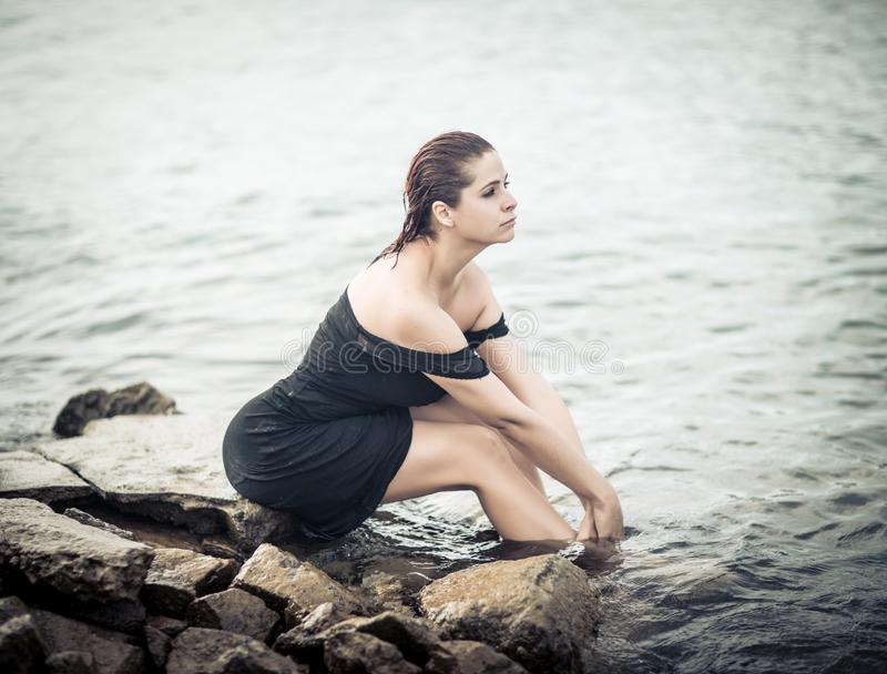 High key portrait of a beautiful woman outdoor. Model near the sea stock photo