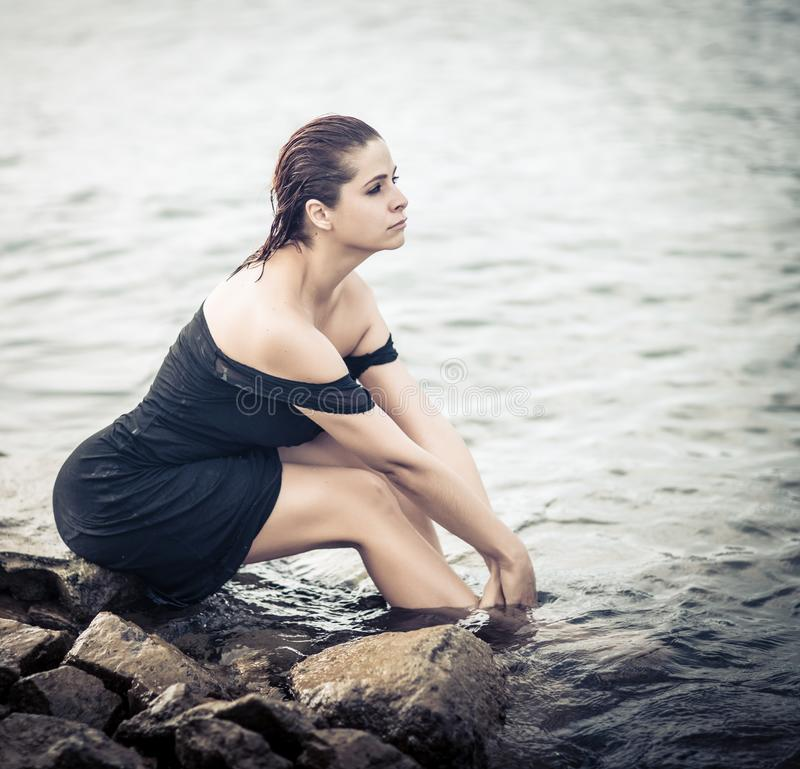 High key portrait of a beautiful woman outdoor. Model near the sea royalty free stock image