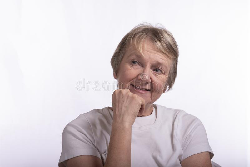 High key portrait of mature female, taken with copy space. On a white background stock photo