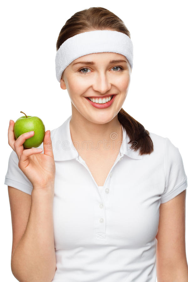 High key Portrait young woman holding green apple isolated on white background. High key Portrait of attractive healthy young woman holding green apple smiling stock photos