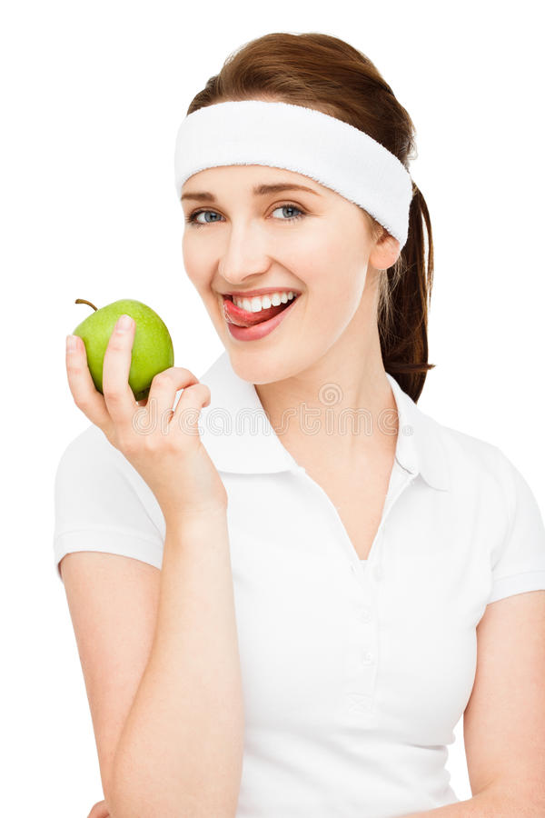 High key Portrait young woman holding green apple isolated on white background. High key Portrait young woman holding green apple smiling royalty free stock photos