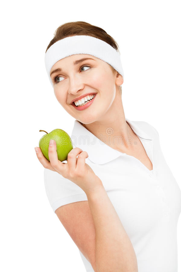 High key Portrait young woman holding green apple isolated on white background royalty free stock images
