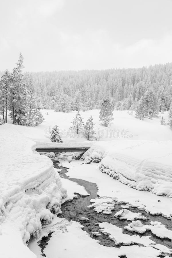 High-key winter landscape with a bridge and a stream. In the foothills of Switzerland stock photography