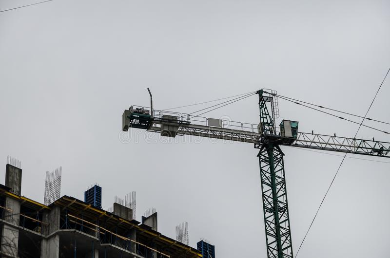 High lift crane on the construction site. On the background of the sky royalty free stock photography