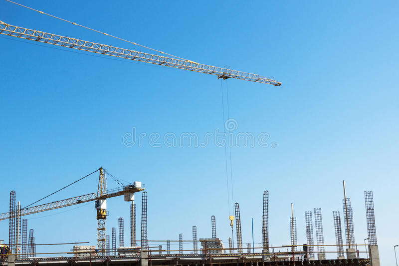 High lift Crane and Worker Woking on Construction Site royalty free stock photo