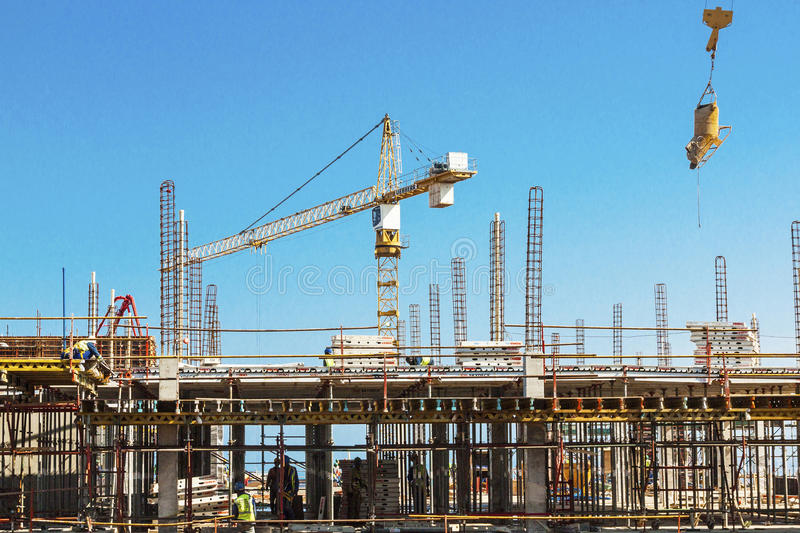 High lift Crane and Workers Woking on Construction Site stock photo